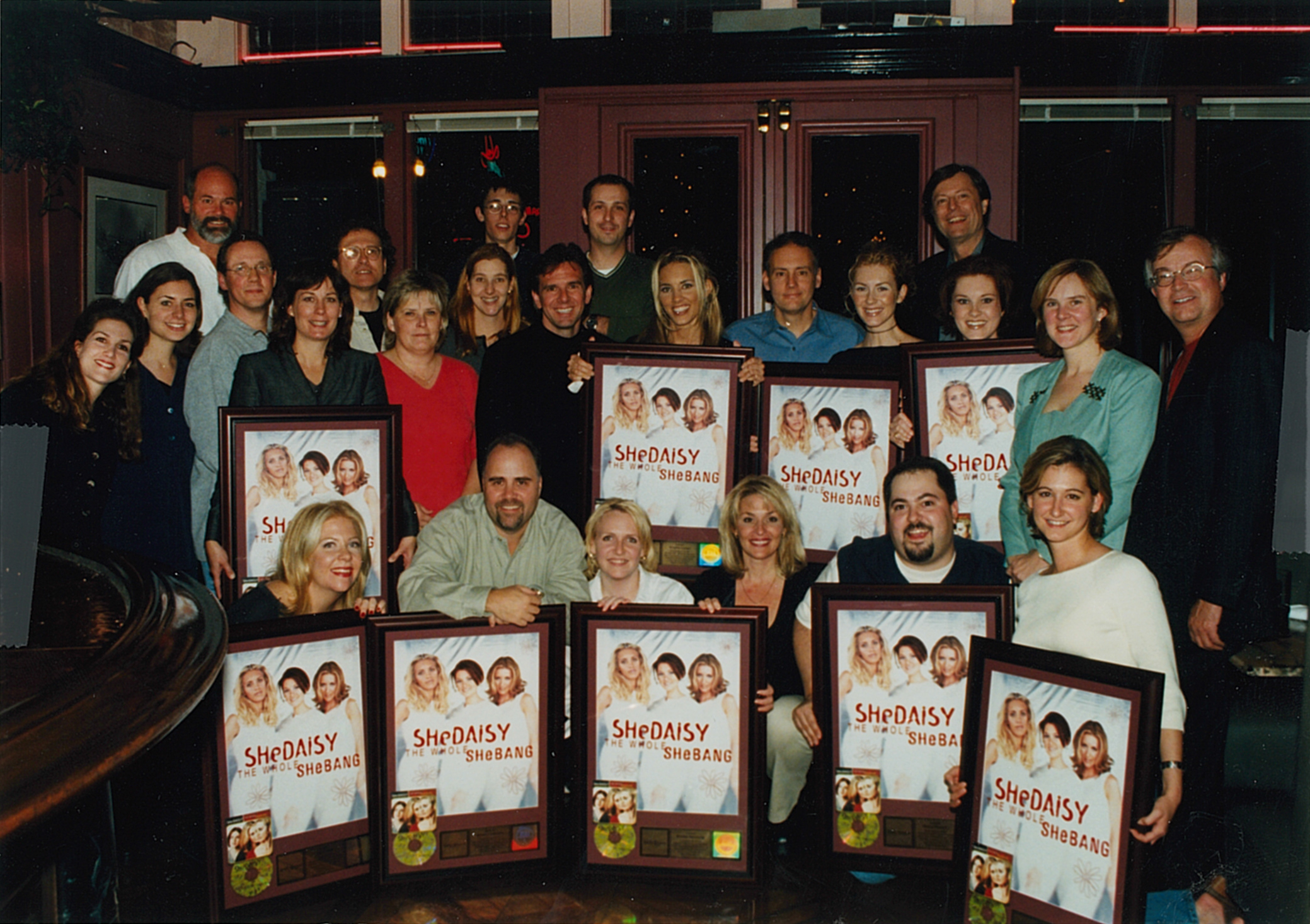 Celebrating Platinum sales success of the SheDaisy album The Whole SheBang with the entire staff of Lyric Street Records